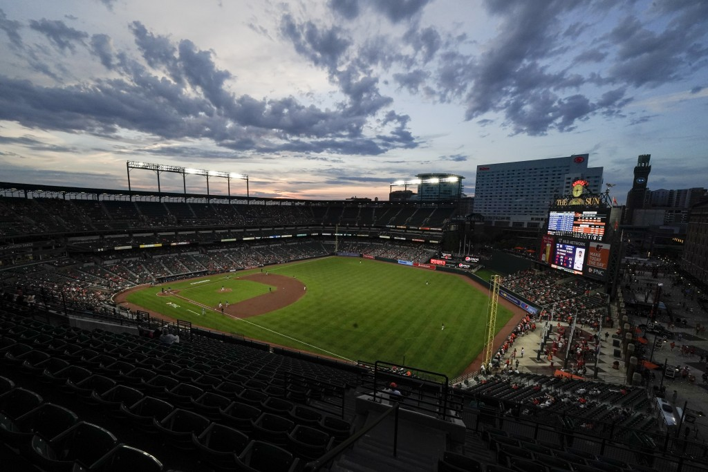 A crowd watches the fifth inning of a baseball game between the Baltimore Orioles and the Toronto Blue Jays, Friday, June 18, 2021, in Baltimore. (AP ...
