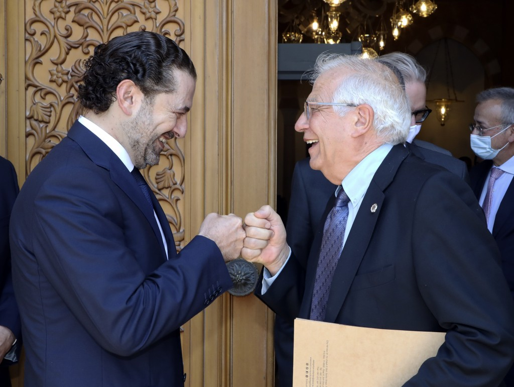 In this photo released by Lebanese government, Lebanese Prime Minister-Designate Saad Hariri, left, greets European Union foreign policy chief Josep B...