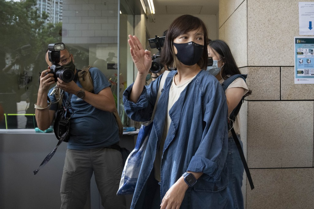 CAPTION CORRECTS JOB TITLE Chan Pui-man, associate publisher of Apple Daily newspaper, walks out from court in Hong Kong, Saturday, June 19, 2021. A H...
