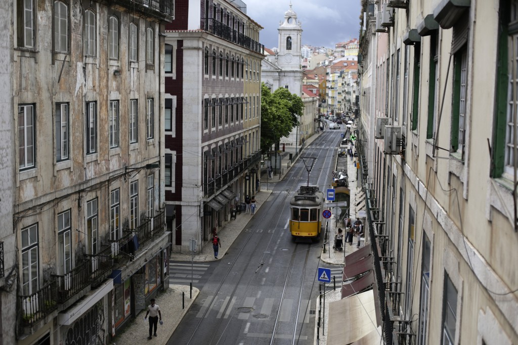 A tram drives through downtown Lisbon, Friday, June 18, 2021. Travel in and out of the Lisbon metropolitan area is to be banned over coming weekends a...