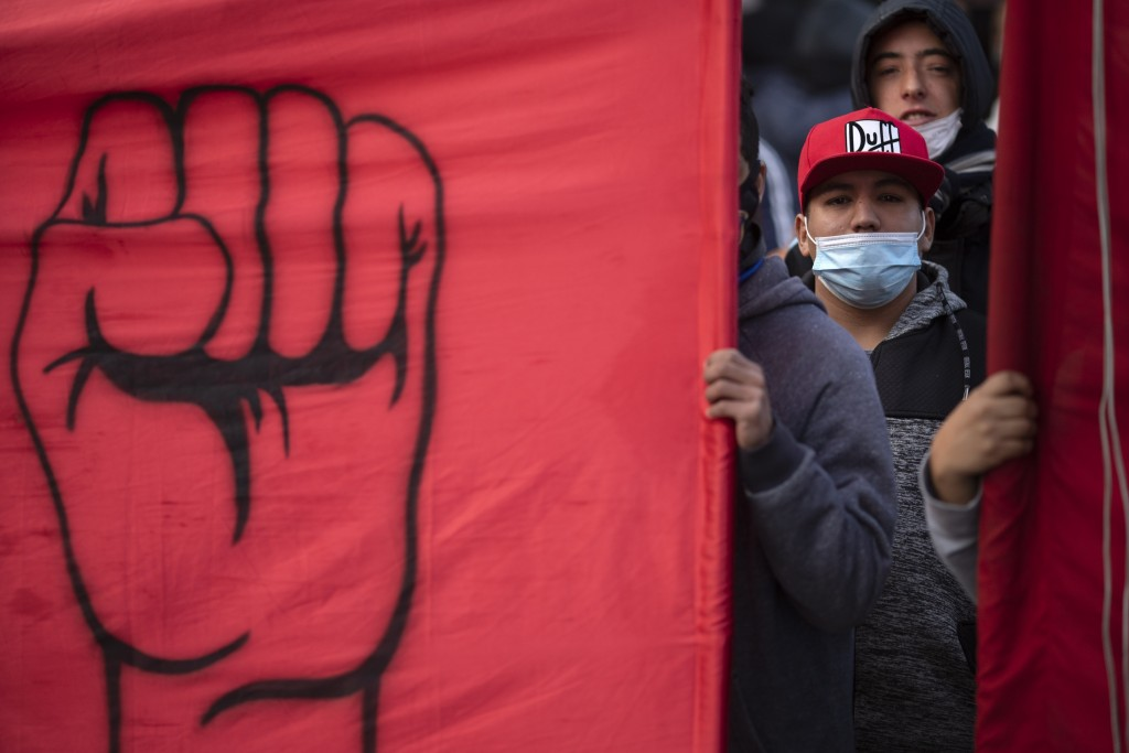 People march to demand better wages and jobs, in Buenos Aires, Argentina, Friday, June 18, 2021. In the midst of a second wave of the new coronavirus,...