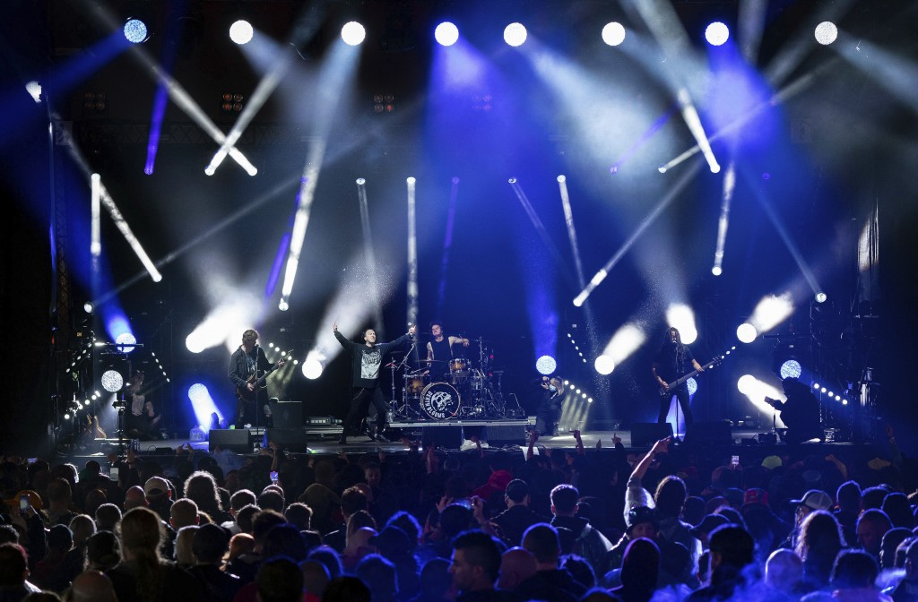 Festivalgoers watch Death Blooms rock band on stage, on the first day of Download Festival at Donington Park at Castle Donington, England, Friday June...