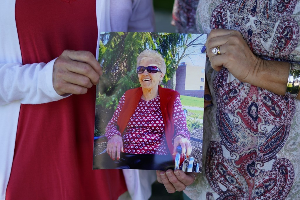 Angela Ermold, right, and her sister, Denise Gracely, hold a photo of their mother, Marian Rauenzahn, Thursday, June 17, 2021, in Fleetwood, Pa. Pande...