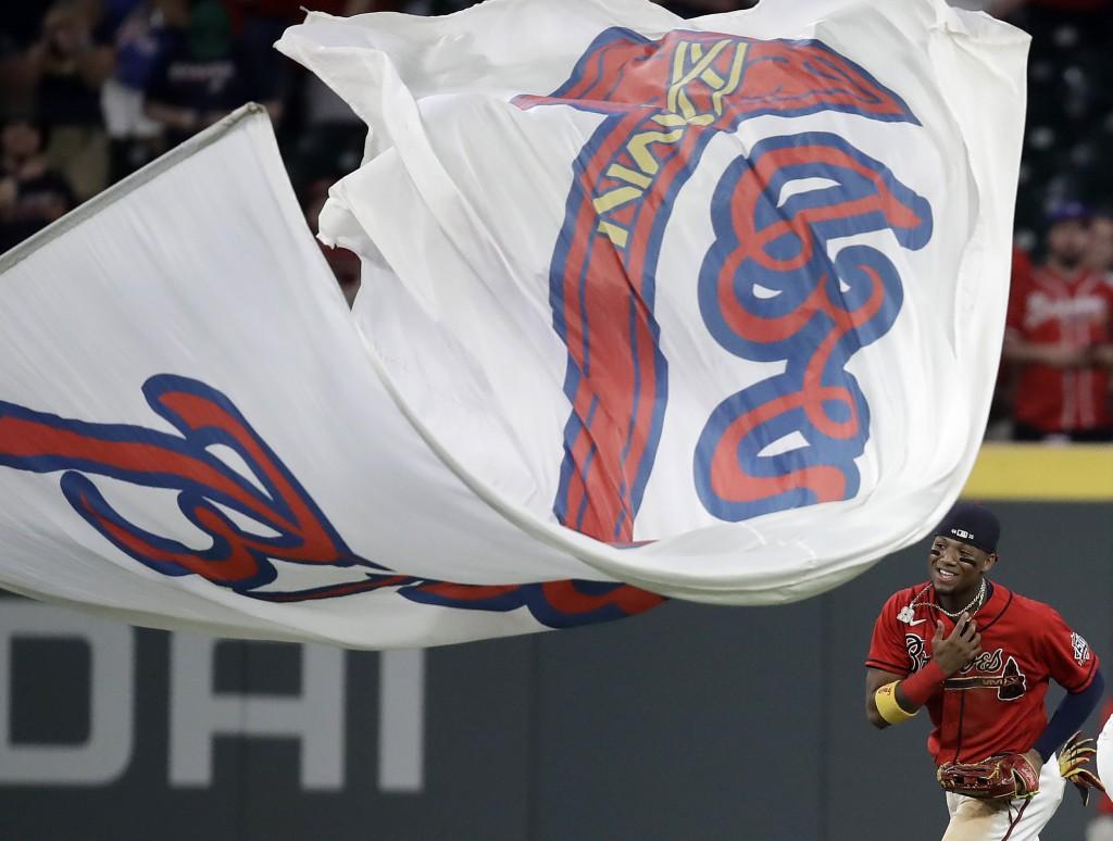 Atlanta Braves' Ronald Acuna Jr. celebrates at the end of a baseball game against the St. Louis Cardinals, Friday, June 18, 2021, in Atlanta. (AP Phot...