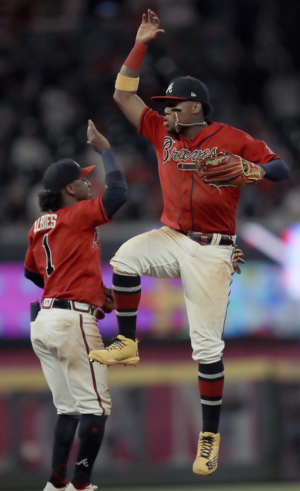 Atlanta Braves' Ronald Acuna Jr., right, celebrates with Ozzie Albies (1) at the end of a baseball game against the St. Louis Cardinals, Friday, June ...