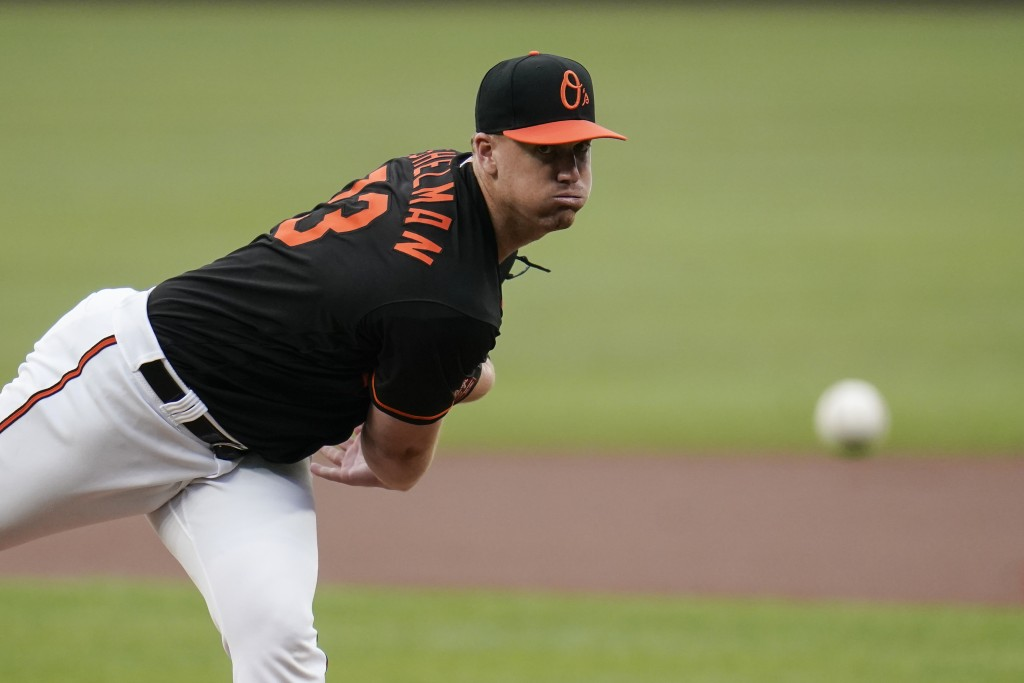 Baltimore Orioles starting pitcher Thomas Eshelman throws a pitch to the Toronto Blue Jays during the first inning of a baseball game, Friday, June 18...