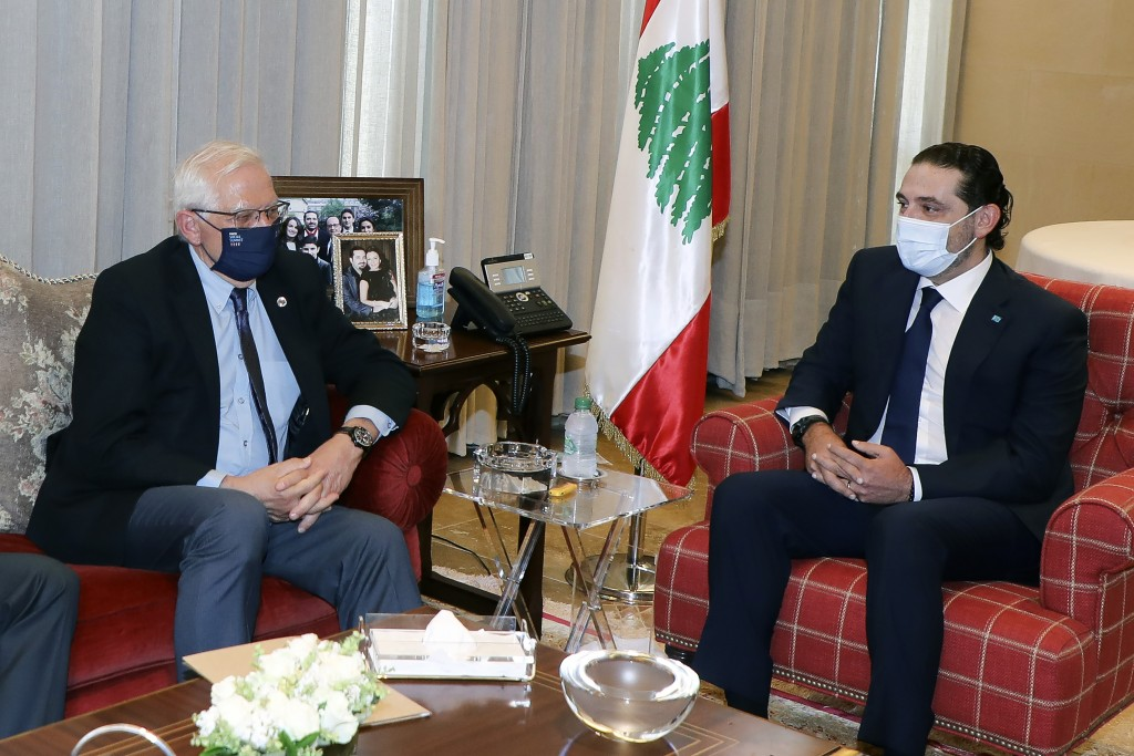 In this photo released by Lebanese government, Lebanese Prime Minister-Designate Saad Hariri, right, meets with European Union foreign policy chief Jo...