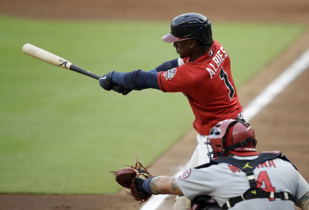 Atlanta Braves' Ozzie Albies swings for a double against the St. Louis Cardinals during the first inning of a baseball game Friday, June 18, 2021, in ...