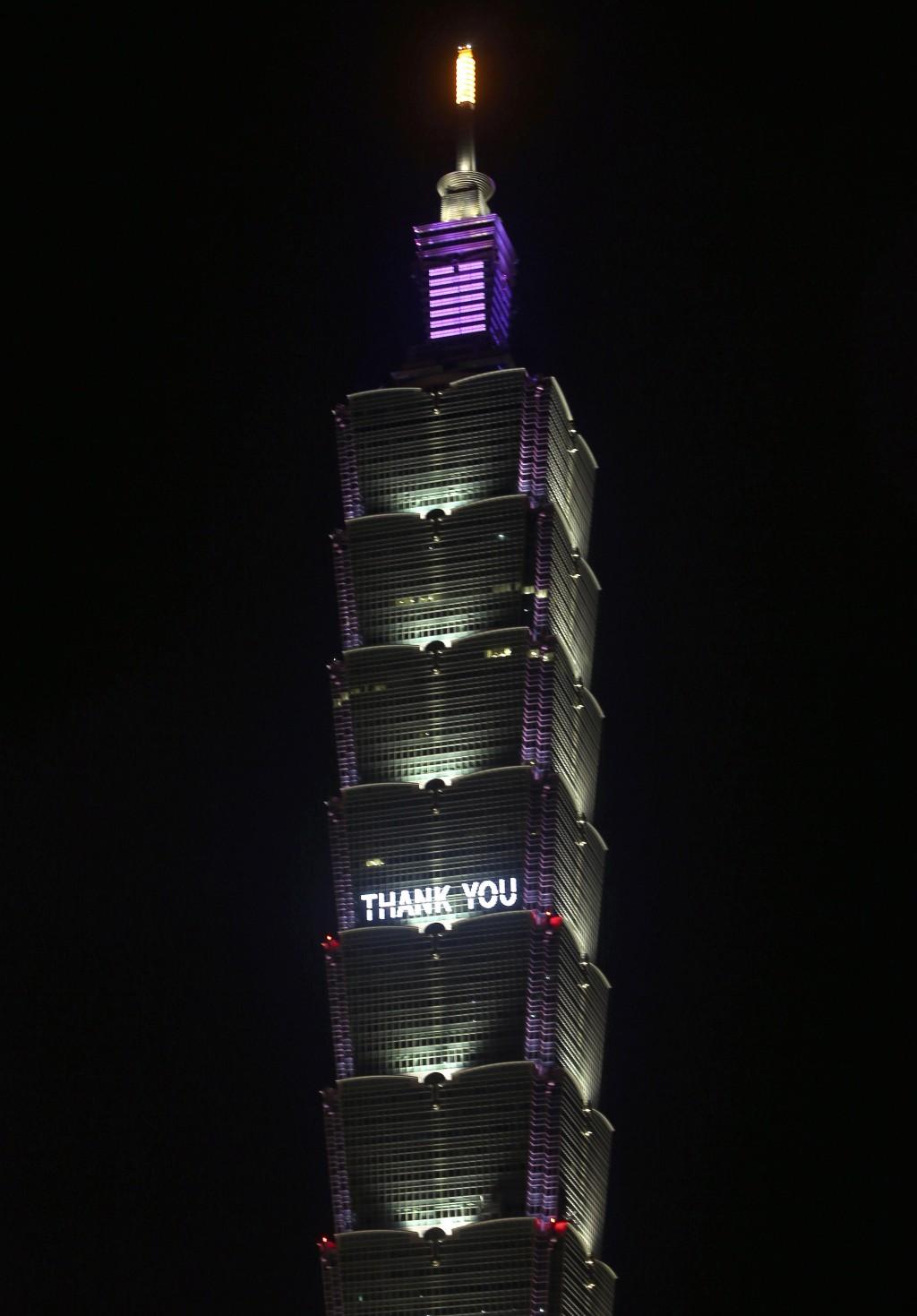 Signs on Grand Hotel, Taipei 101 thank US for 2.5 million Moderna jabs