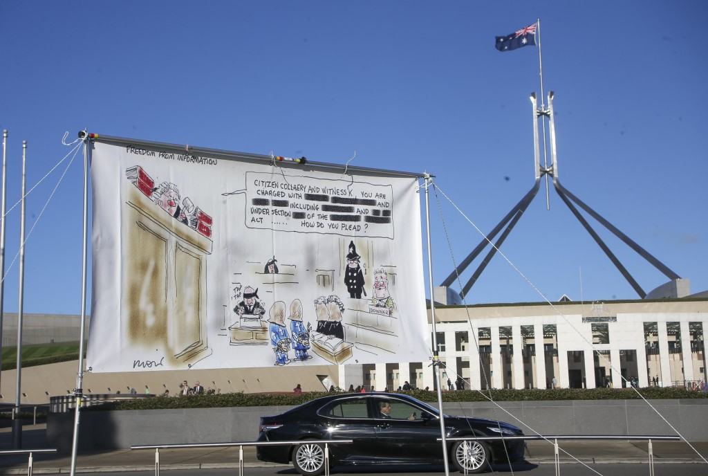 A large banner hangs outside Parliament House in Canberra, Australia, Thursday, June 17, 2021 during a protest against the prosecution of lawyer Berna...