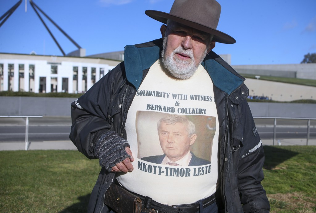 Demonstrator Dierk von Behrens protests outside Parliament House in Canberra, Australia, Thursday, June 17, 2021 against the prosecution of lawyer Ber...
