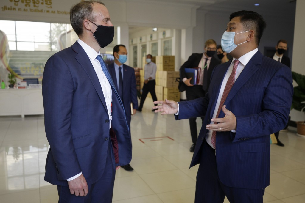 Britain's Foreign Secretary Dominic Raab, left, talks with Cambodian's Environment Minister Say Sam Al  after a meeting in Phnom Penh, Cambodia Wednes...