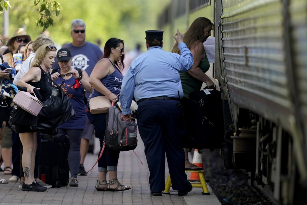 FILE - In this June 11, 2021, file photo, passengers board a Missouri River Runner Amtrak train in Lee's Summit, Mo. As the U.S. emerges from the COVI...