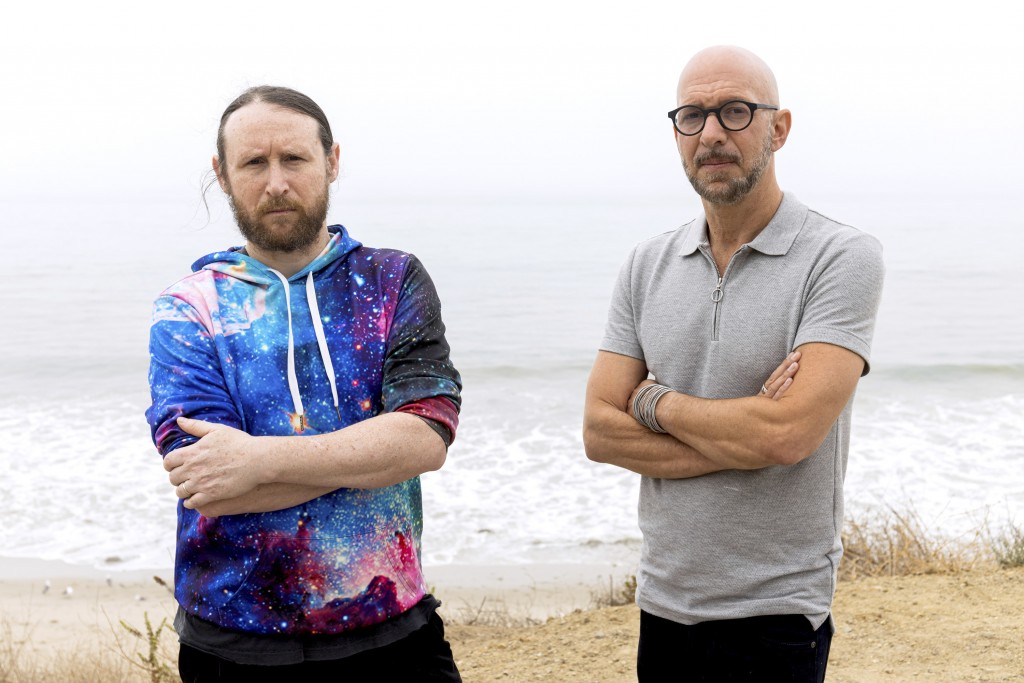 """Author Neil Strauss, right, and Incubus guitarist Mike Einziger, of the podcast """"To Live and Die in LA,"""" pose for a portrait on Thursday, June 17, 202..."""