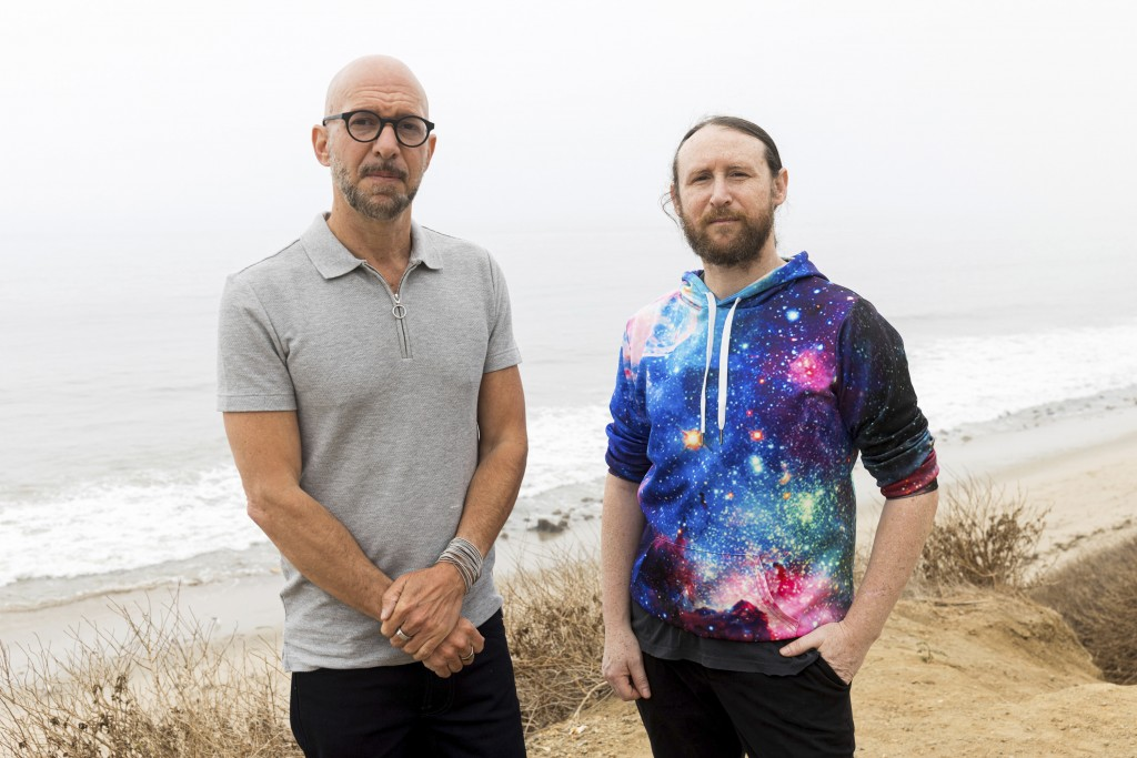 """Author Neil Strauss, left, and Incubus guitarist Mike Einziger, of the podcast """"To Live and Die in LA,"""" pose for a portrait on Thursday, June 17, 2021..."""