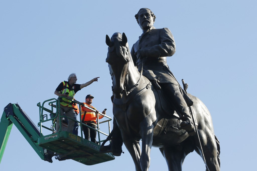 FILE - In this Monday June 8, 2020 file photo a crew from the Virginia Department of General Services inspect the statue of Confederate Gen. Robert E....