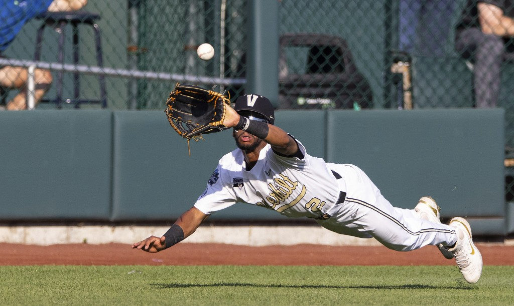 Vanderbilt's Javier Vaz (2) dives to catch a ball hit by Stanford's Eddie Park to close out the second inning during a baseball game in the College Wo...
