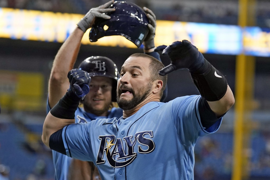 Tampa Bay Rays' Mike Zunino, front, celebrates his two-run home run off Boston Red Sox starting pitcher Garrett Richards with Brett Phillips during th...