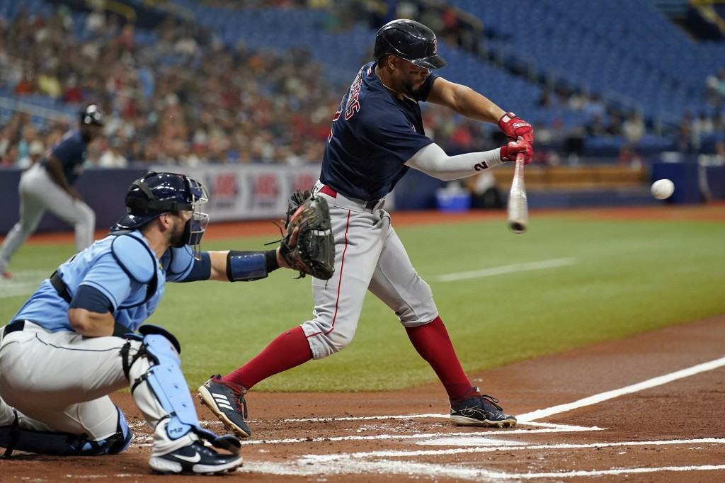 Boston Red Sox's Xander Bogaerts lines an RBI single off Tampa Bay Rays starting pitcher Rich Hill during the first inning of a baseball game Wednesda...