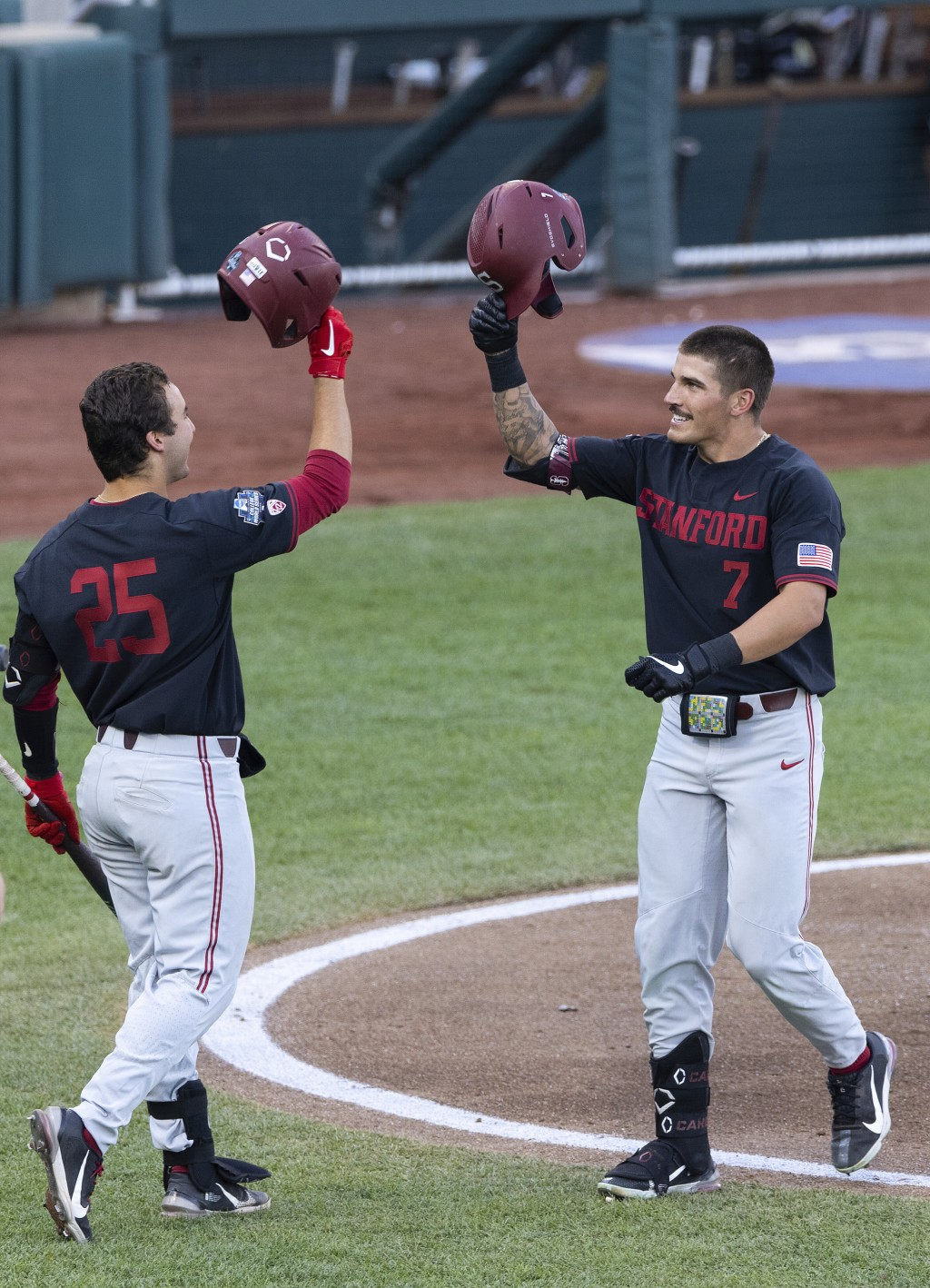 Stanford's Brock Jones (7), right, celebrates with Kody Huff (25) after hitting a home run in the third inning during a baseball game in the College W...