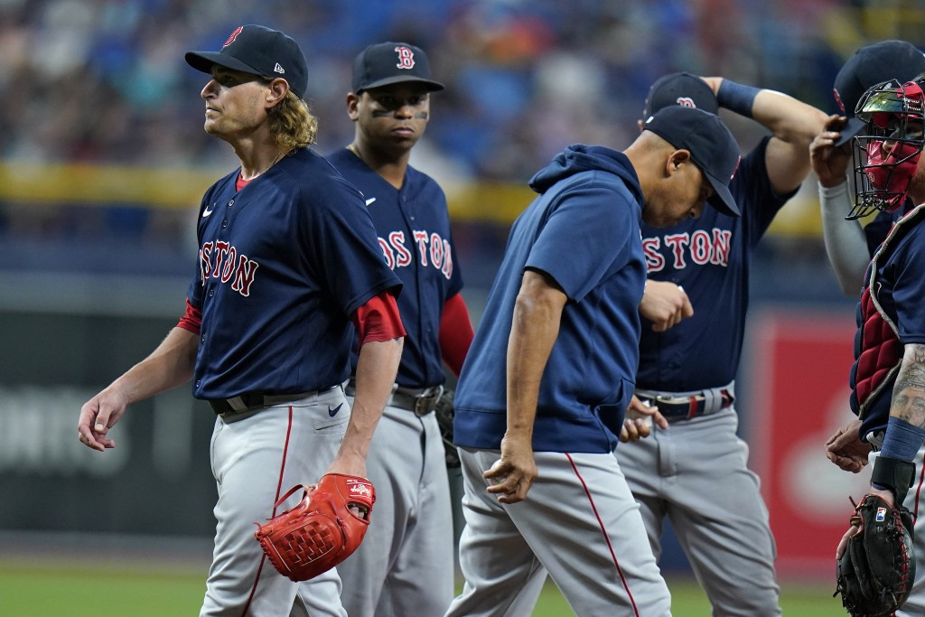 Boston Red Sox starting pitcher Garrett Richards, left, is taken out of the game by manager Alex Cora, center, during the second inning of a baseball ...