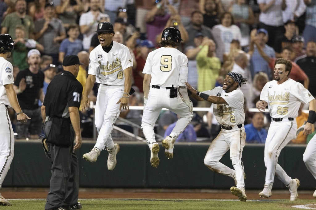 Vanderbilt's Isaiah Thomas (8), from left, Carter Young (9), Javier Vaz (2) and Parker Noland (25) celebrate their 6-5 win against Stanford during a b...