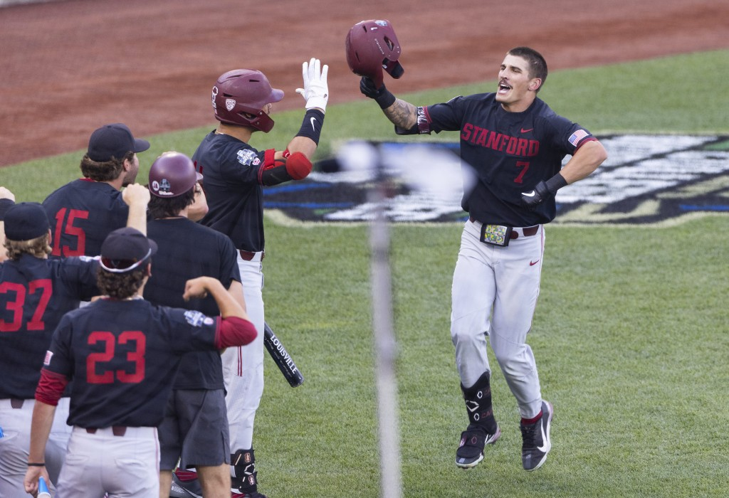 Stanford's Brock Jones (7), right, celebrates with teammates after hitting a home run against Vanderbilt in the third inning during a baseball game in...