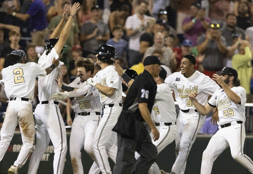 Vanderbilt players celebrate their 6-5 win against Stanford during a baseball game in the College World Series Wednesday, June 23, 2021, at TD Ameritr...