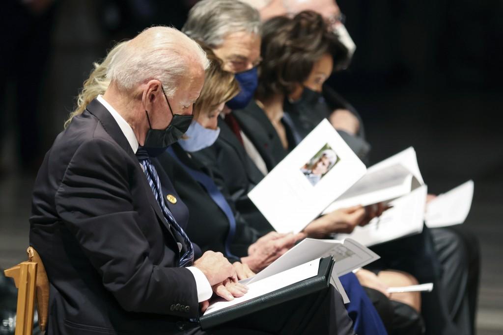 President Joe Biden attends the funeral service for former Virginia Sen. John Warner at the Washington National Cathedral, Wednesday, June 23, 2021, i...