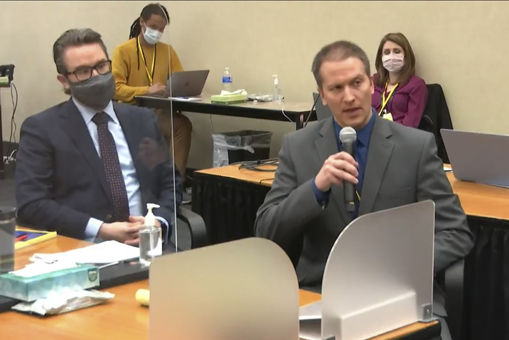 FILE - In this April 15, 2021, file image from video, defense attorney Eric Nelson, left, and defendant, former Minneapolis police officer Derek Chauv...