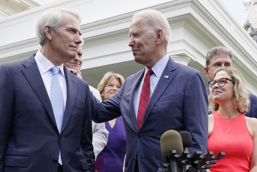 President Joe Biden speaks with Sen. Rob Portman, R-Ohio, and other bipartisan group of senators, Thursday June 24, 2021, outside the White House in W...