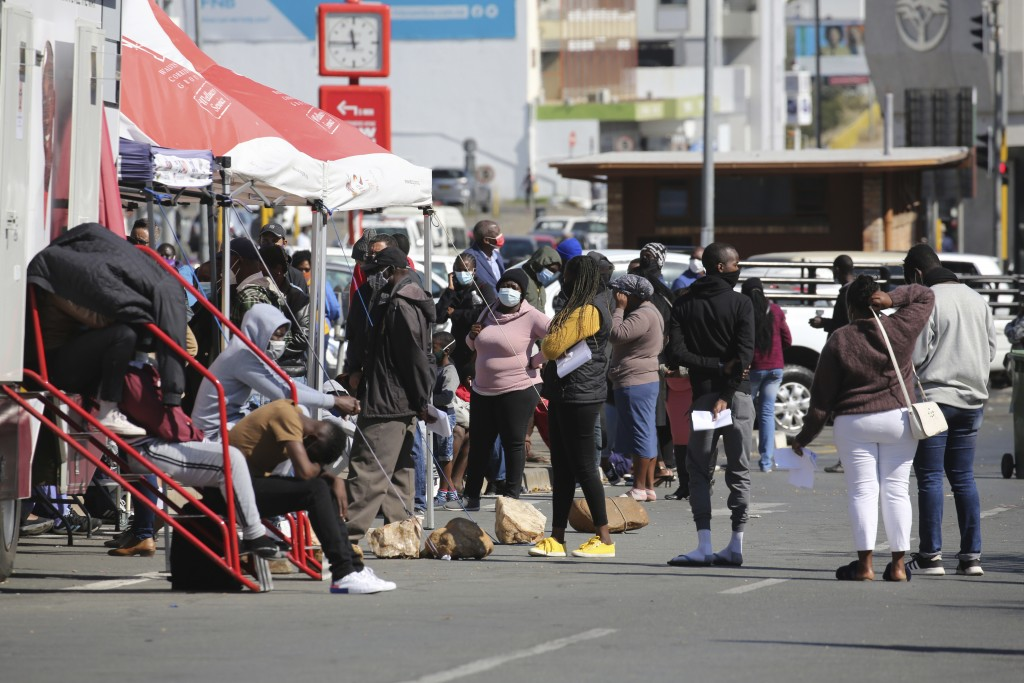 People queue in the Windhoek, Namibia centre, to be tested for COVID-19 on Tuesday June 15, 2021. Africa is facing a devastating resurgence of COVID-1...