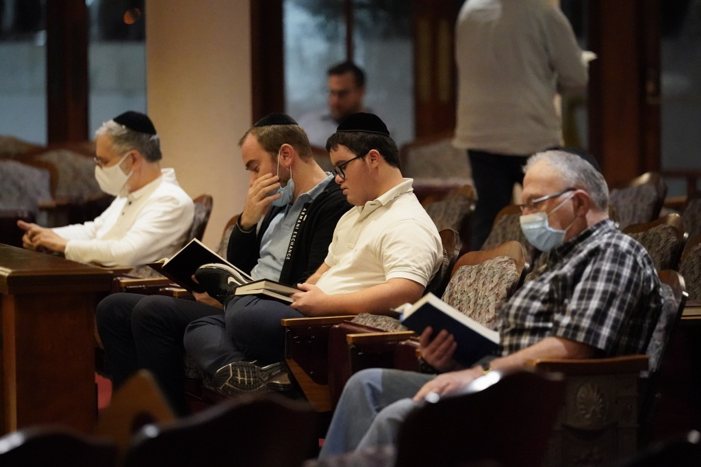 Jewish faithful pray at the Shul of Bal Harbour after members of the community were reported missing in the partial collapse of a 12-story beachfront ...