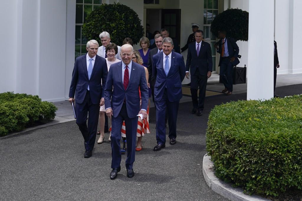 President Joe Biden, with a bipartisan group of senators, walks to speak Thursday June 24, 2021, outside the White House in Washington. Biden invited ...