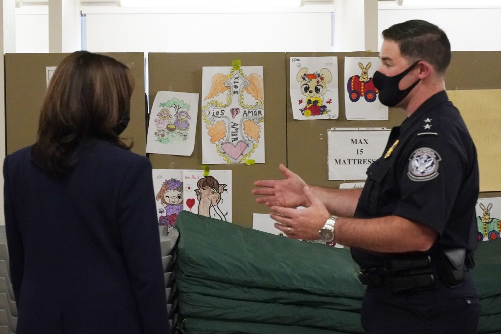 Vice President Kamala Harris looks at pictures drawn by children as she visits the Paso del Norte (PDN) Port of Entry in El Paso, Texas, Friday, June ...