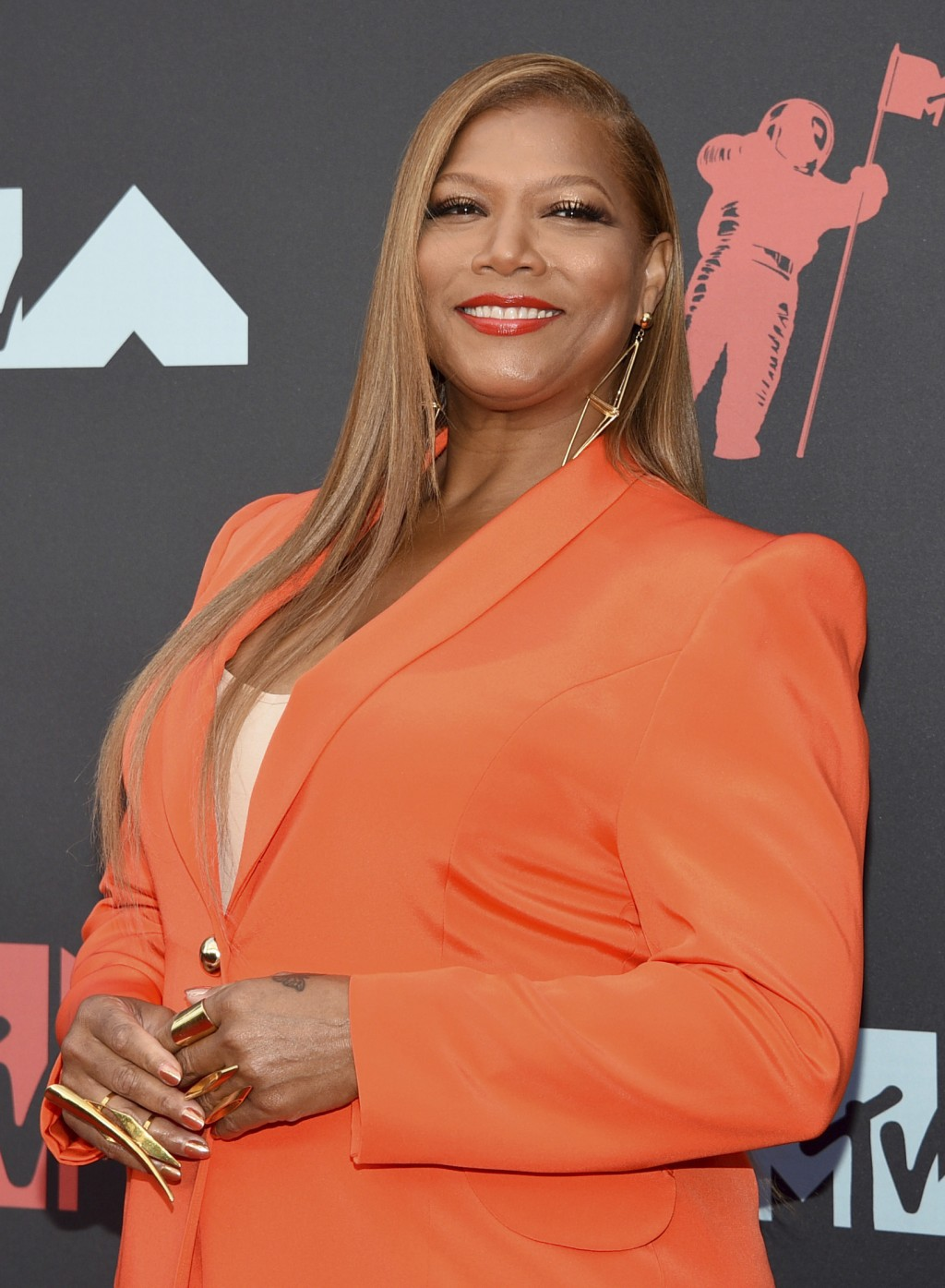 FILE - Queen Latifah arrives at the MTV Video Music Awards on Aug. 26, 2019, in Newark, N.J. Queen Latifah will be honored at Sunday's BET Awards. (Ph...