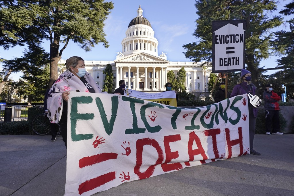 FILE - In this Jan 25, 2021 file photo demonstrators calling for lawmakers and Gov. Gavin Newsom to pass rent forgiveness and stronger eviction protec...