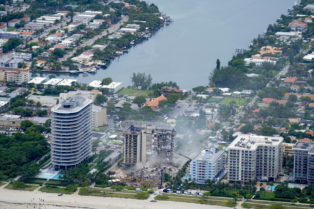 In this aerial view the rubble at the Champlain Towers South Condo is seen, Friday, June 25, 2021, in Surfside. The apartment building partially colla...