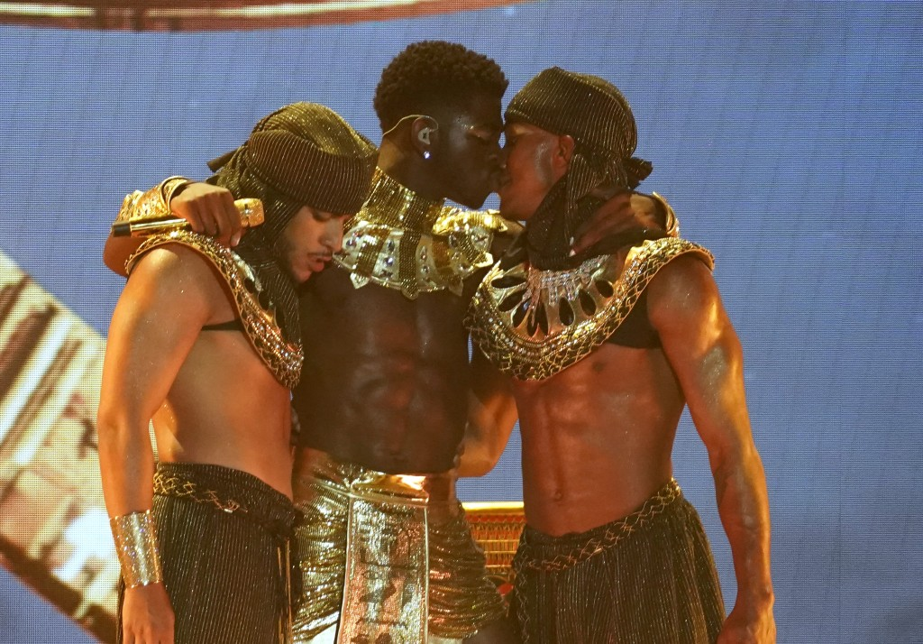 Lil Nas X, center, kisses a dancer at the conclusion of his performance at the BET Awards on Sunday, June 27, 2021, at the Microsoft Theater in Los An...