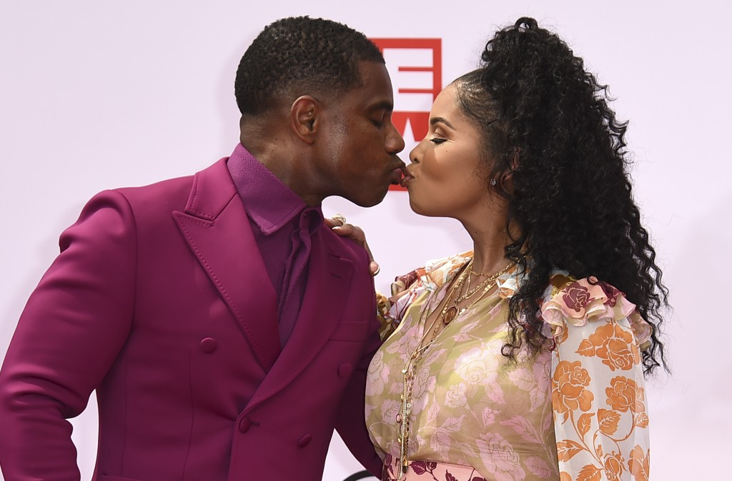 Kirk Franklin, left, and Tammy Collins kiss as they arrive at the BET Awards on Sunday, June 27, 2021, at the Microsoft Theater in Los Angeles. (Photo...
