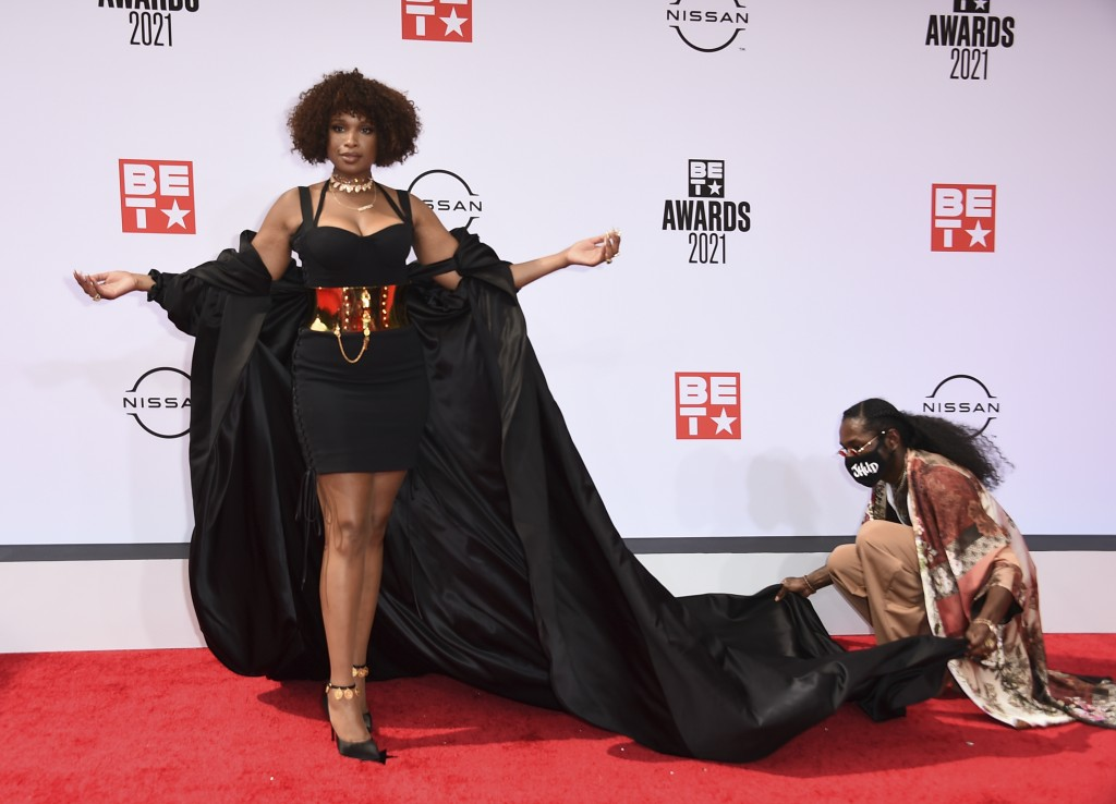 An assistant helps with Jennifer Hudson's outfit as she poses at the BET Awards on Sunday, June 27, 2021, at the Microsoft Theater in Los Angeles. (Ph...