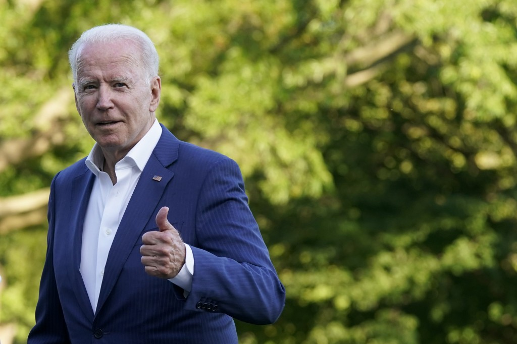 President Joe Biden gestures as he walks on the South Lawn of the White House after stepping off Marine One, Sunday, June 27, 2021, in Washington. Bid...