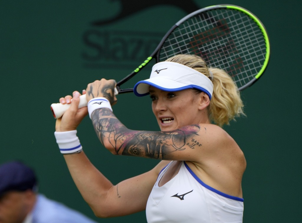 Czech Republic's Tereza Martincova plays a return to Alison Riske of the US during the women's singles first round match on day two of the Wimbledon T...