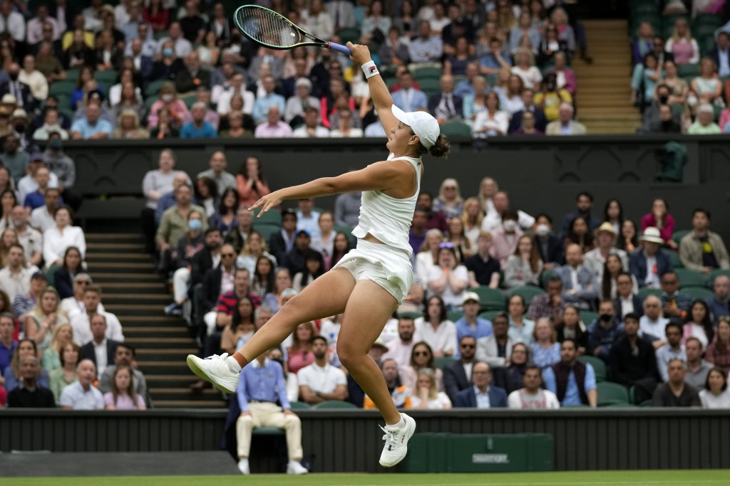 Australia's Ashleigh Barty plays a return to Spain's Carla Suarez Navarro during the women's singles first round match on day two of the Wimbledon Ten...