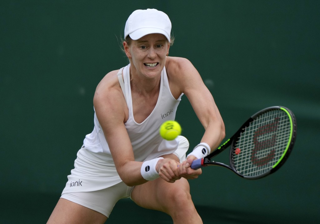 Alison Riske of the US plays a return to Czech Republic's Tereza Martincova during the women's singles first round match on day two of the Wimbledon T...