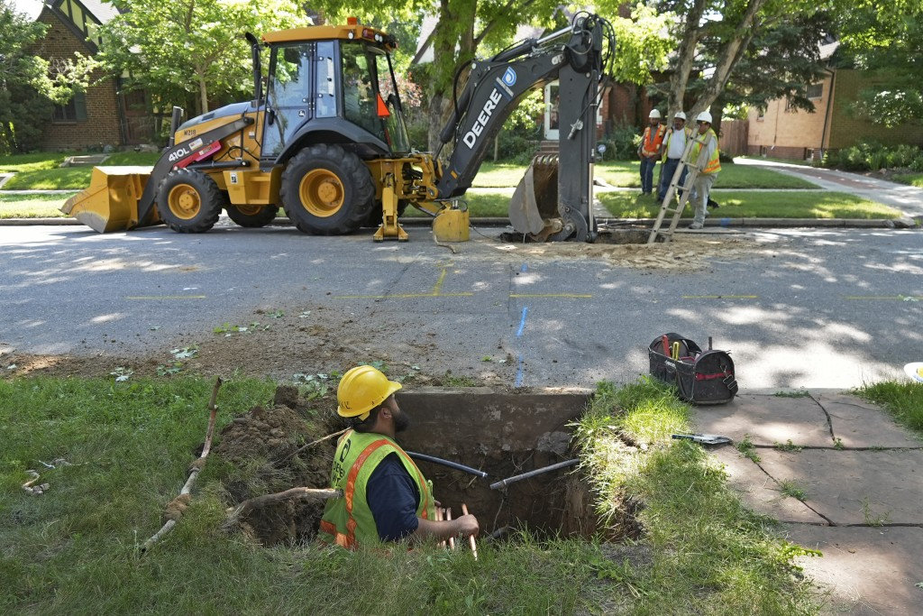 A Denver Water crew works to replace a lead water service line installed in 1927 with a new copper one at a private home on Thursday, June 17, 2021, i...