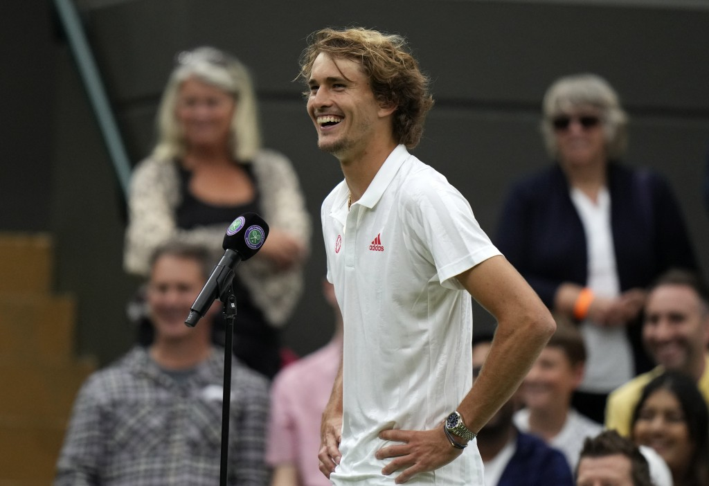 Germany's Alexander Zverev is interviewed on court after winning the men's singles first round match against Tallon Griekspoor of the Netherlands on d...