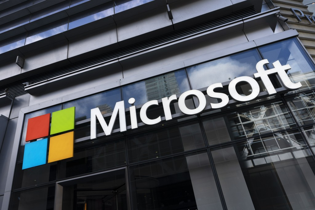 This May 6, 2021 photo shows a sign for Microsoft offices in New York.