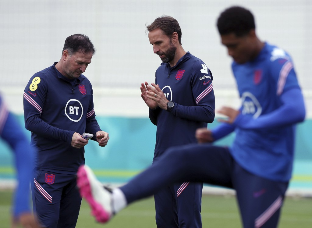 England manager Gareth Southgate, center, speaks with Steve Holland during a training session at St George's Park, Burton upon Trent, England, Wednesd...