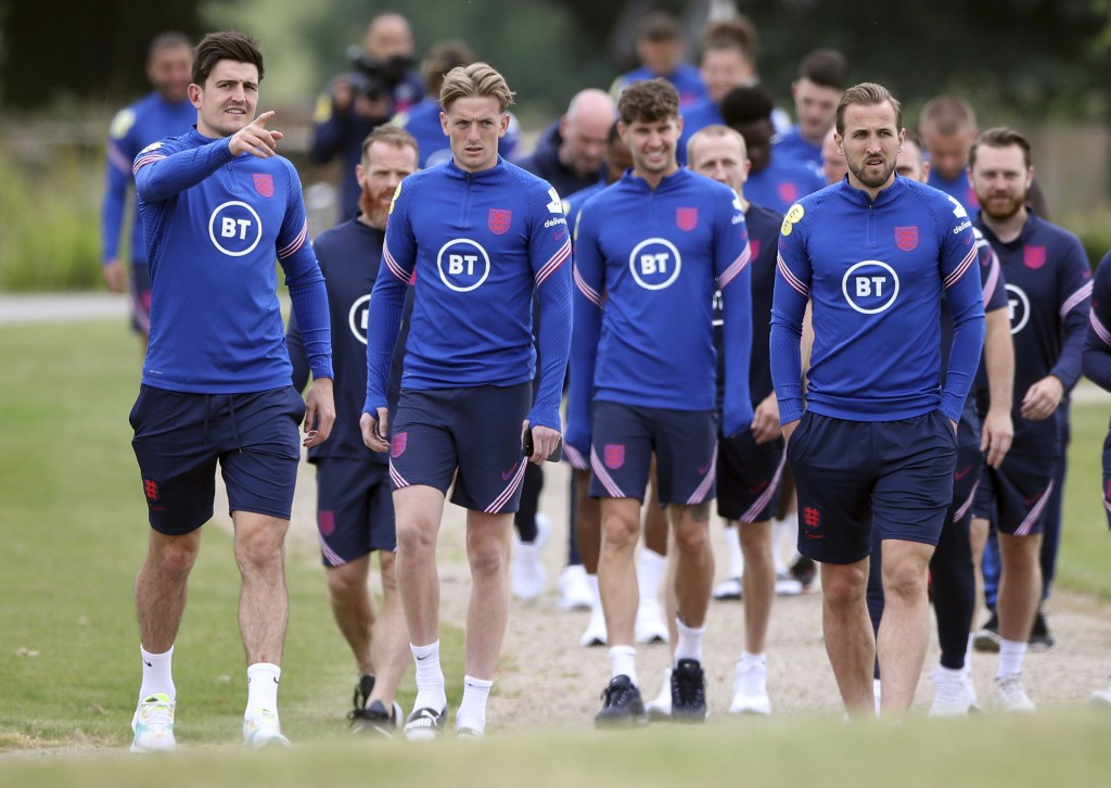 England's Harry McGuire, Jordan Pickford, John Stones and Harry Kane, from left, arrive for a training session at St George's Park, Burton upon Trent,...